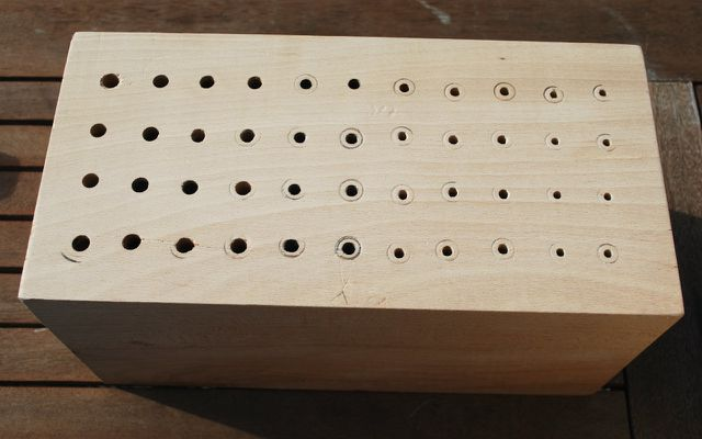 drilled wooden block
