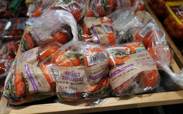 Tomatoes in plastic wrap packaging waste
