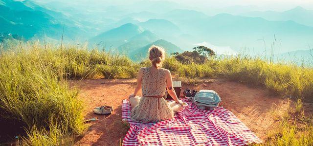 Becoming minimalist woman mountain picnic