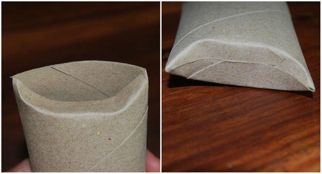 An jedem Ende der Klorolle knickst du die Pappe ein.
