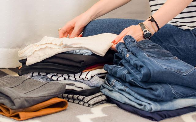 Minimalist closet clearing sorting clothes