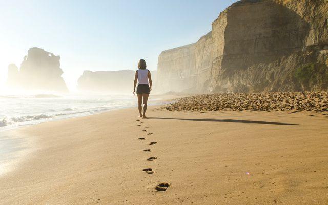 Self-improvement think for yourself woman walking seashore